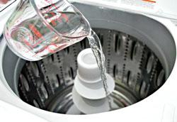 Как почистить стиральную машину с вертикальной загрузкой?